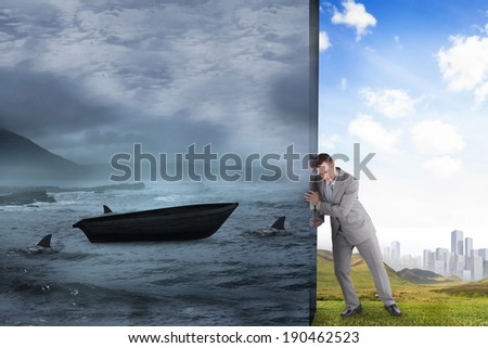 Composite image of businessman pushing away scene of sail boat being circled by sharks - stock photo