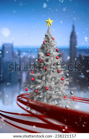 Composite image of christmas tree with falling snow - stock photo