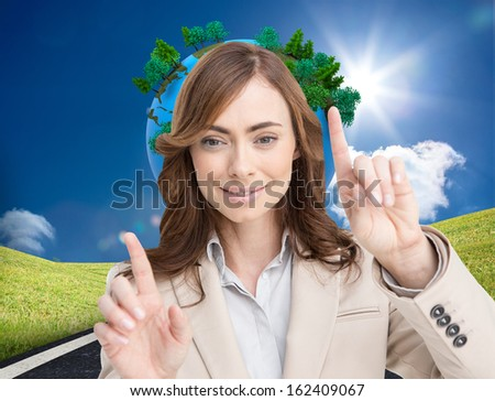 Composite image of classy businesswoman touching invisible screen - stock photo