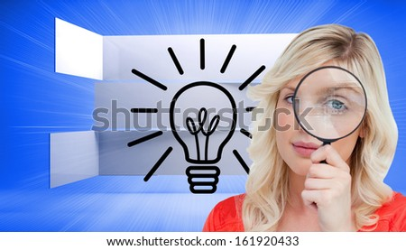 Composite image of fair-haired woman looking through a magnifying glass  - stock photo
