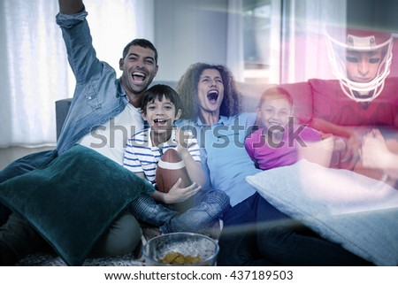 Composite image of family are watching sport on television at home - stock photo