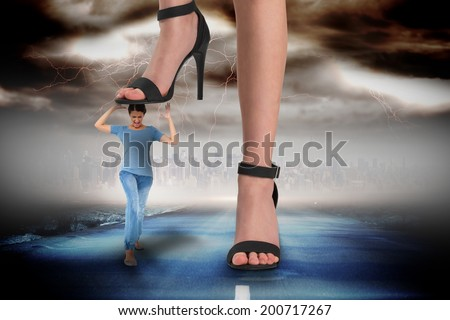 Composite image of female feet in black sandals stepping on girl against stormy sky with tornado over road - stock photo