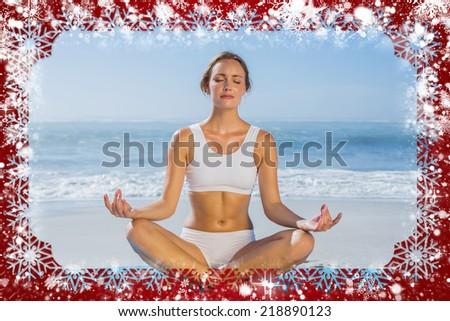 Composite image of fit woman sitting in lotus pose on the beach against snow - stock photo