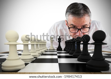 Composite image of focused businessman with chessboard - stock photo