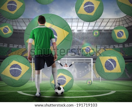 Composite image of football player about to take a penalty against football pitch in large stadium - stock photo