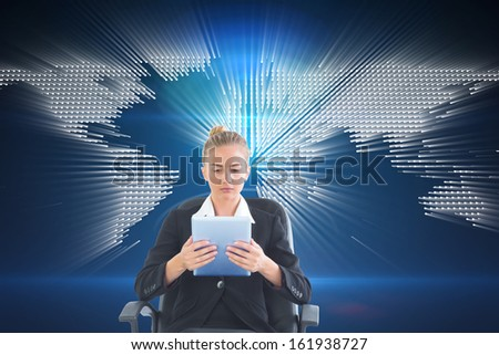 Composite image of front view of concentrated chic businesswoman using her tablet sitting on an office chair - stock photo