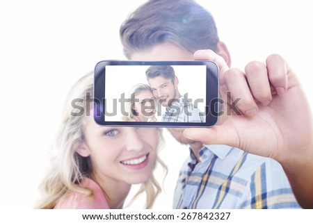 Composite image of hand holding smartphone showing - stock photo