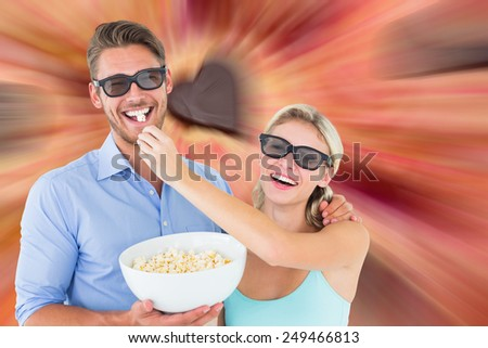 Composite image of happy young couple wearing 3d glasses eating popcorn - stock photo