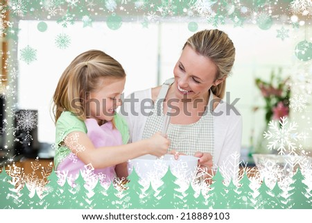 Composite image of mother and daughter having fun in the kitchen against snow - stock photo