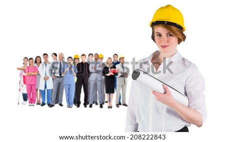 Composite image of pretty young architect smiling at camera against group of workers - stock photo
