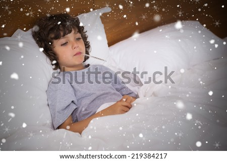 Composite image of sick child with thermometer resting in bed against snow falling - stock photo