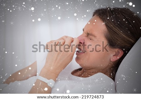 Composite image of side view of sneezing woman against snow - stock photo