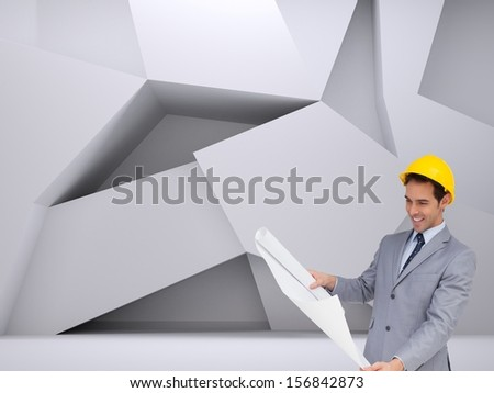 Composite image of smiling architect with hard hat looking at plans standing in abstract room - stock photo