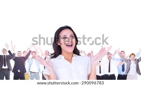 Composite image of surprised brunette with hands up and smiling - stock photo