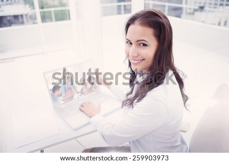 Composite image of team having meeting with one woman smiling at camera - stock photo