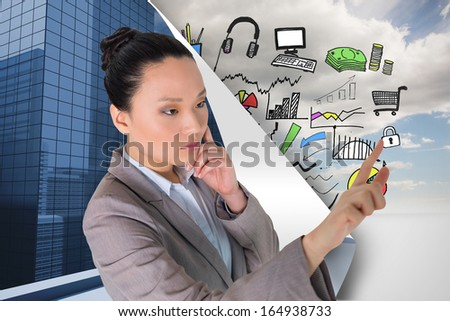 Composite image of thoughtful asian businesswoman pointing - stock photo