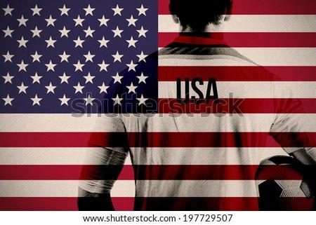 Composite image of usa football player holding ball against usa national flag - stock photo