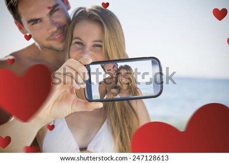 Composite image of valentines couple taking a selfie - stock photo