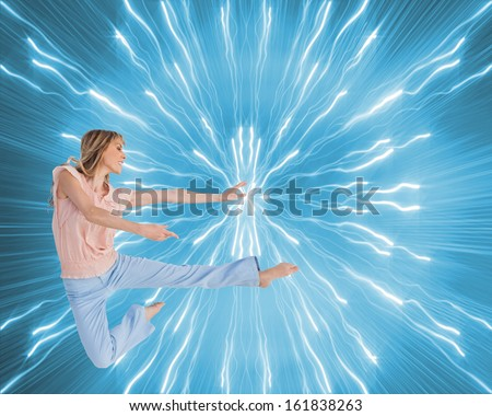 Composite image of woman doing dance pose - stock photo