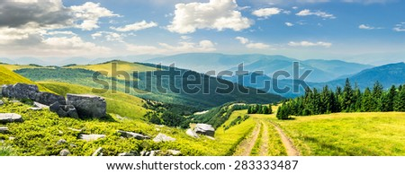 composite mountain landscape. path through meadow on mountain range with huge boulders near pine forest on hill side in morning light - stock photo