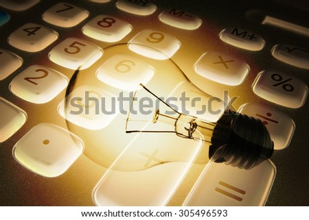 Composite of Calculator and Light Bulb - stock photo