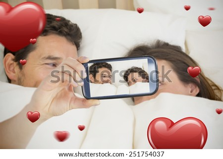 Composite of Couple taking Valentines selfie - stock photo