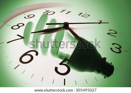 Composite of Wall Clock and Light Bulb - stock photo