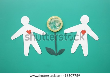 Composition from a condom and silhouettes of people. - stock photo