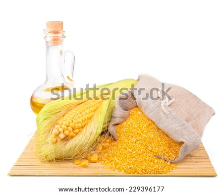 Composition from corn, maize flour in sack, oil on the mat isolated on white background - stock photo