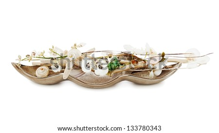 Composition from pearls, coral and orchids isolated on white background. - stock photo