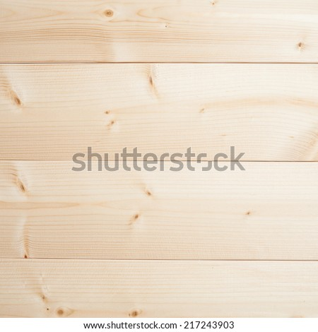 Composition made of polished pine wood board planks as a background texture - stock photo