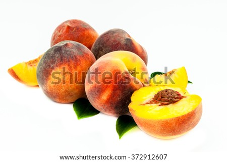 Composition of a bunch of peaches on a white background - stock photo