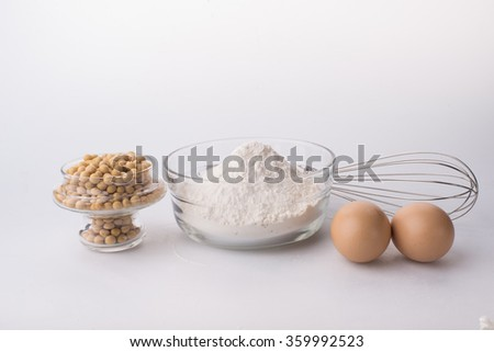 Composition of flour and eggs. Isolated on a white background. - stock photo