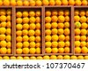 Composition of fresh oranges in the box - stock photo