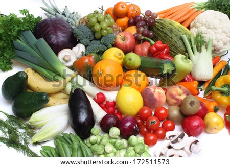 Composition of fruits and vegetables against a white isolated background - stock photo