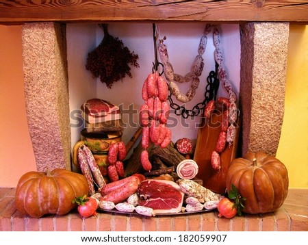 Composition of italian cold cuts in an old fireplace - stock photo