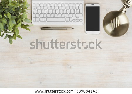 Composition of keyboard, telephone, table lamp, plant and ink pen - stock photo