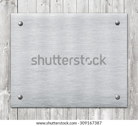 Composition of metal aluminum plaque, name plate on wooden wall planks - stock photo