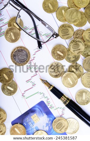 Composition of money, glasses, pen and financial charts - stock photo