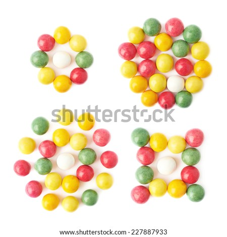 Composition of multiple chewing gum balls isolated over the white background, top view above, set of four different images - stock photo