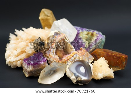 composition of natural gem stones on a black background - stock photo