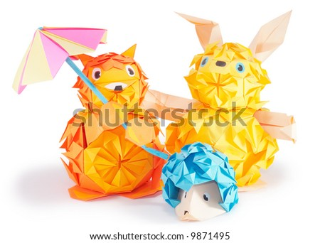 Composition of origami figures (hare, hedgehog, fox) isolated on white (with shadows and clip path) - stock photo