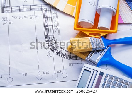 composition of paintoing tools on blueprint  - stock photo