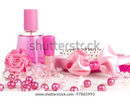 composition of pink: perfume, a comb, ribbon, beads, nail polish - stock photo
