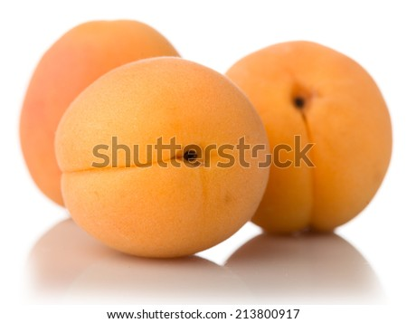 composition of ripe juicy apricots isolated on white background - stock photo