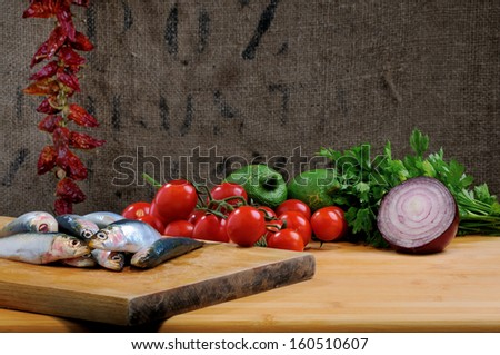 composition of sardines with various ingredients - stock photo