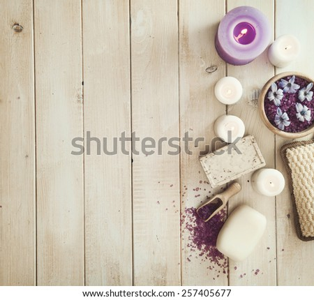 Composition of spa treatment on the white wooden table - stock photo