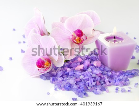 Composition of spa treatment: Orchids and sea salt with candle/Spa treatment/Spa therapy - stock photo