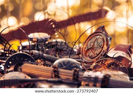 Composition of the old broken watches, with protruding springs and tools - stock photo