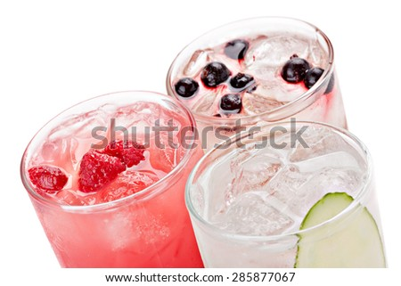 Composition of the three variants of alcoholic cocktails, isolated on white background.Top view. - stock photo